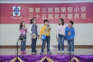 圖二為學生們為校慶作精彩表演,贏得台下熱烈掌聲。