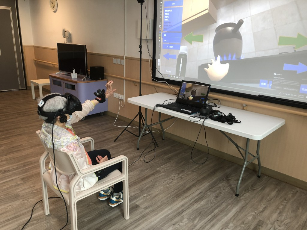 """Photo 2: """"VRehab Generation"""" Project developed a set of VR training programme kit, providing service users a close-to-reality training environment."""