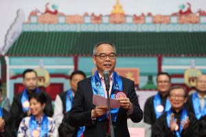 """Officiating guest, the Hon. LAU Kong Wah, JP, Secretary for Home Affairs, delivered a speech at the Kick-off Ceremony of the """"Man Mo Parade to Celebrate the 170th Anniversary of TWGHs Man Mo Temple cum 20th Anniversary of the Establishment of the HKSAR""""."""